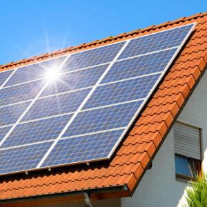 Domestic solar panels Ireland on roof of house.