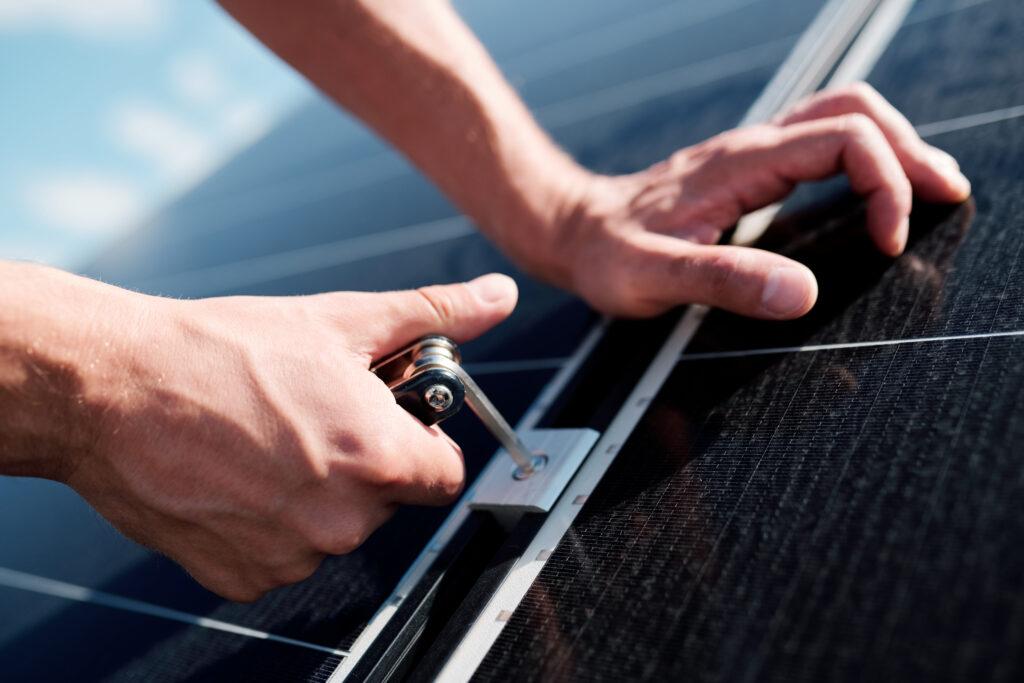 Technician fitting solar panels in Ireland.